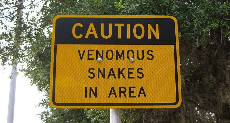 Caution Venomous Snakes in Area Sign
